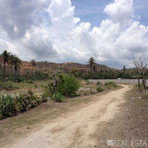 Panoramic hilltop land with ocean view for sale in Lombok.